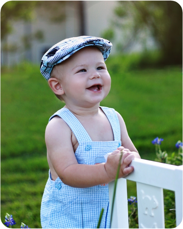 one year old baby boy wearing flat cap in the bluebonnets the woodlands