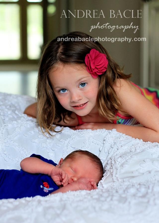 newborn baby boy and big sister at home