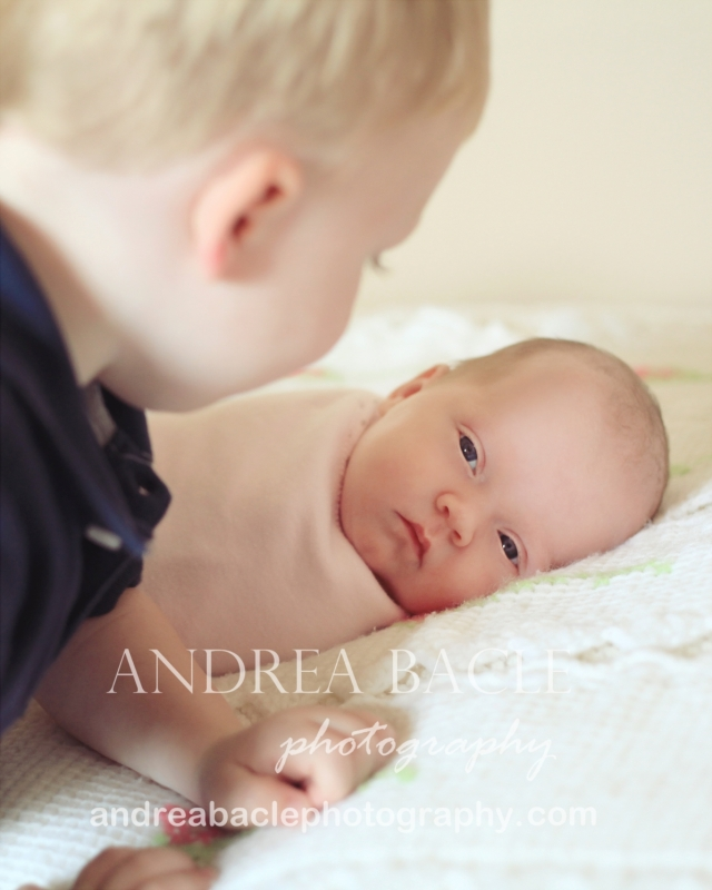 big toddler brother baby newborn girl sister the woodlands family photographer