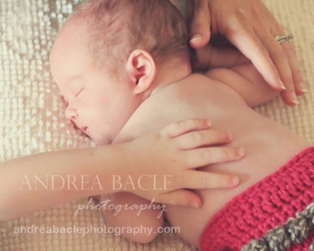 newborn baby girl mom's hand big brother's hand the woodlands tx photographer