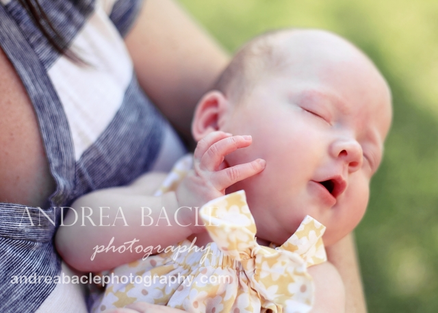 mom holding newborn baby girl the woodlands tx family lifestyle photographer