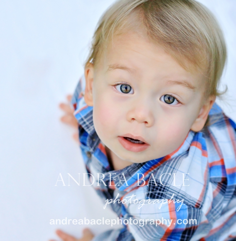 Newborn baby boy with blue eyes and brown hair