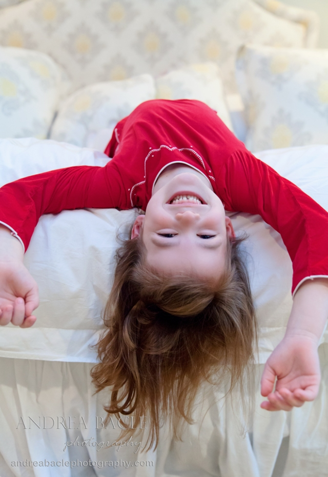 silly six year old girl upside down