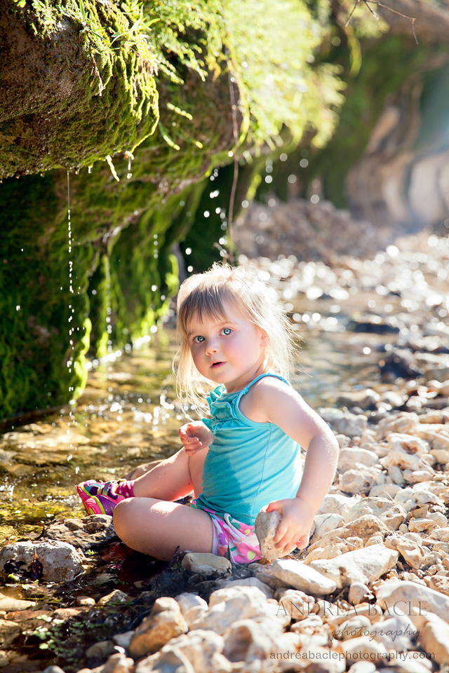 two year old girl in the creek new braunfels destination photographer