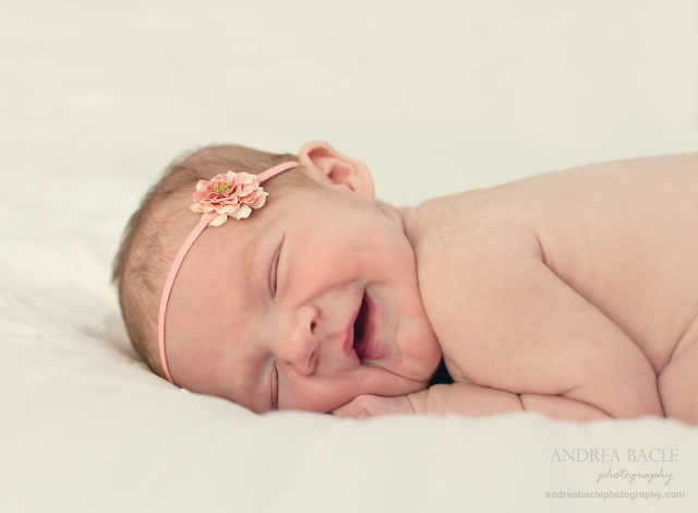 newborn baby girl smiling