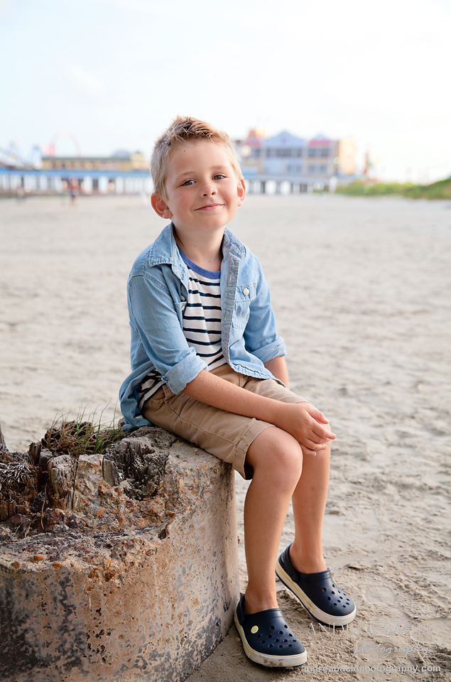 galveston family session seven year old boy by pleasure pier