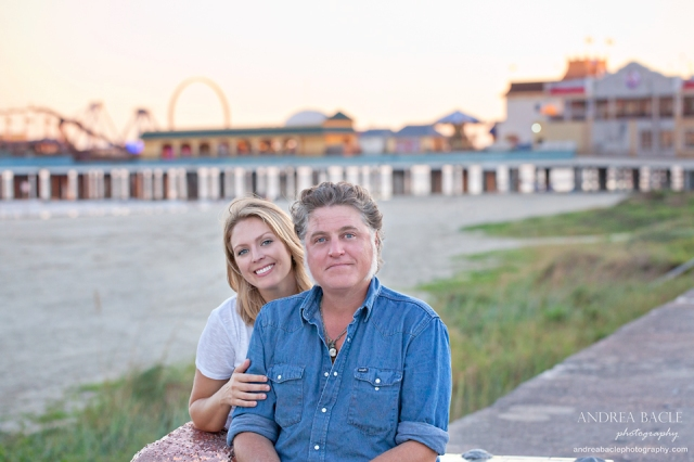 galveston beach couple in love in front of pleasure pier