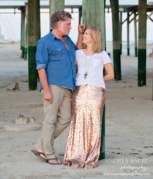 galveston beach couple in love under the pier