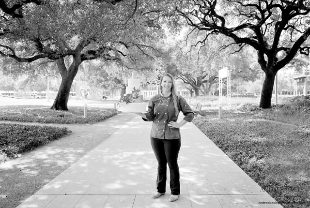 black and white kelly q holding cake discovery green