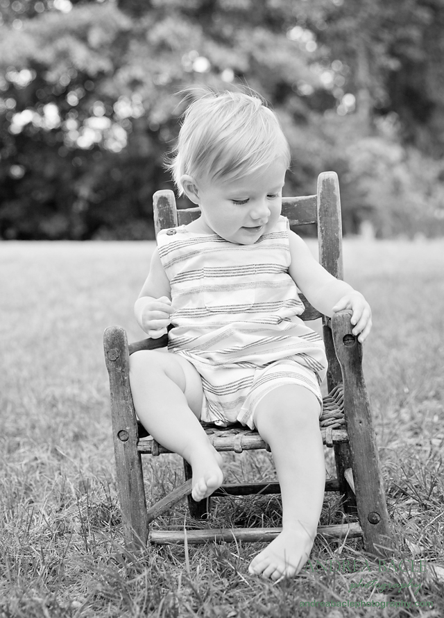 black and white heirloom family chair first birthday pics